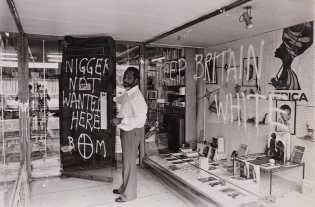 Image of Eric Huntley discovering Bogle L'Ouverture has been vandalised, 1977.